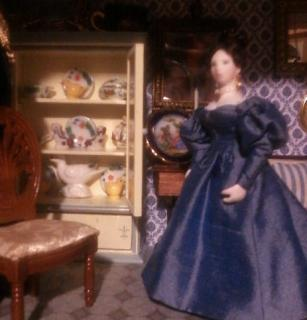 Frau Adelina playing around with Her china cabinet.