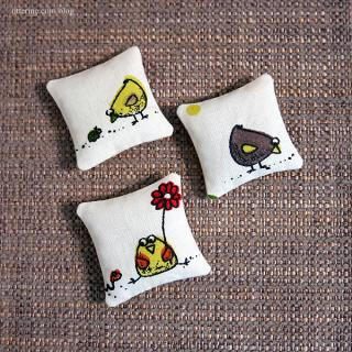 Quirky bird pillows