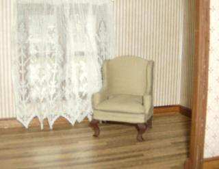 Lily living room,  I covered the chair and made the curtains