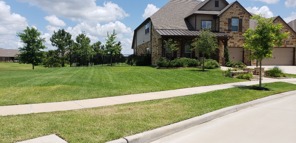 Yard mowing company in Houston , TX, 77084