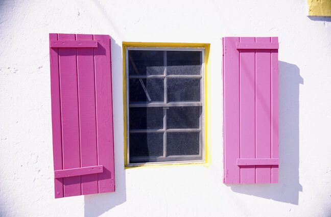 HOA regulations prevented homeowner from plum colored shutters