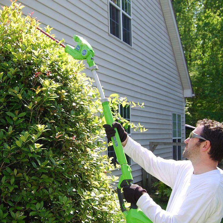 Extended-reach hedge trimmers provide a safe and easy way to trim tall hedges.