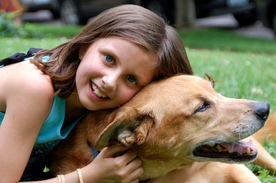 girl-hugging-a-dog