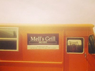 Mell's Grill Logo