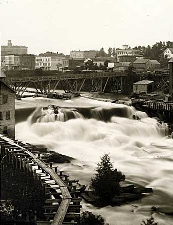 2_St. Anthony Falls, East Side_1865_courtesy Minnesota Historical Society_Description--Photograph of the east side of St. Anthony Falls showing a sawmill in the foreground and the Winslow House in the upper left