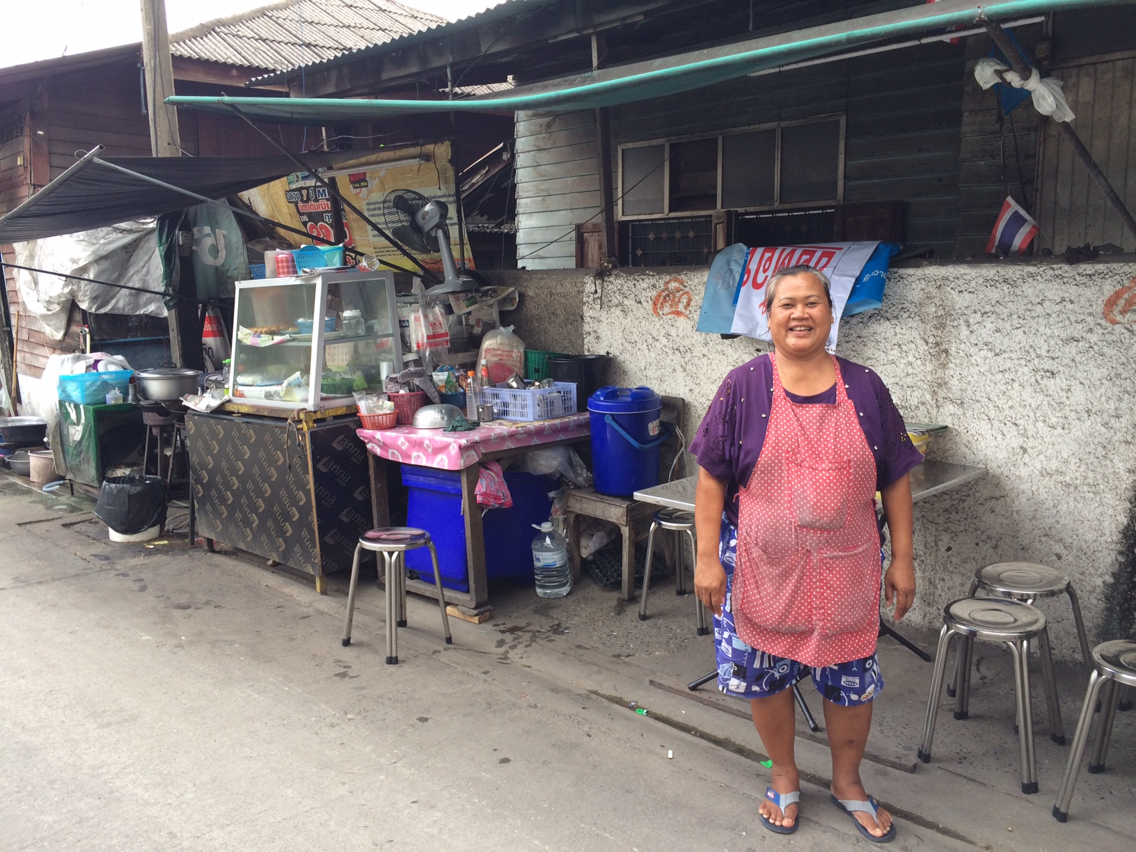Bangkok street food stall in dusty back alley