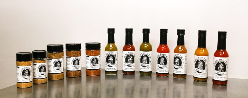 The full hot sauce lineup from Isabel Street Heat // Photo by Aaron Davidson, Growler Magazine