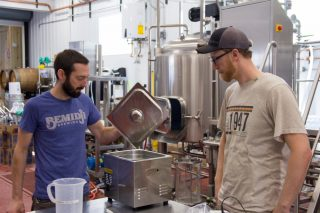 Bemidji Brewing head brewer Tom Hill and brewer Chris Marty inspect a new piece of equipment // Photo by Brian Kaufenberg