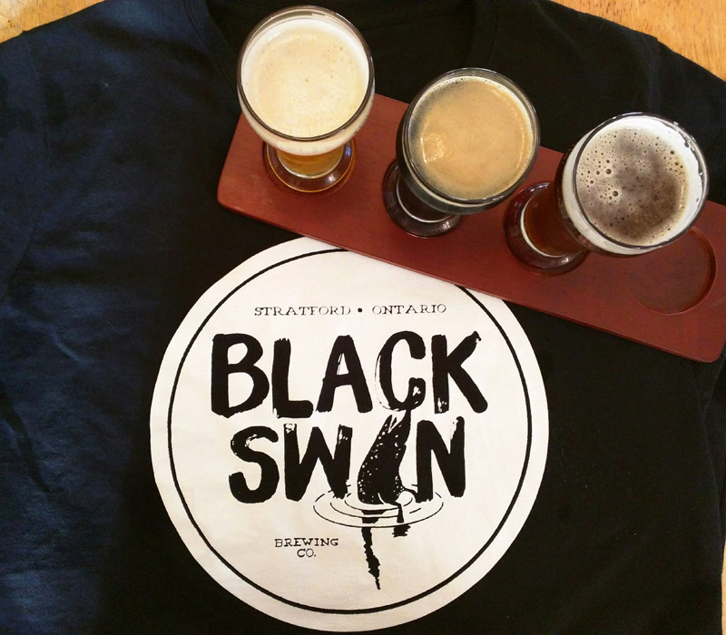 "Black Swan features four beers in regular rotation. Pictured from L to R: the sour Berliner weisse, ""Wild Child;"" the porter; and the English Pale Ale. // Photo by Cristeta Boarini"