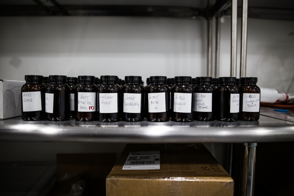 Different herbal blends sit on the shelf at Dampfwerk Distillery // Photo by Aaron Davidson