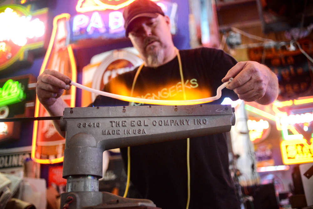 Matt Thompson applies his 30 years of sign-making experience at his Minneapolis shop, Skyline Neon // Photo by Dan Murphy