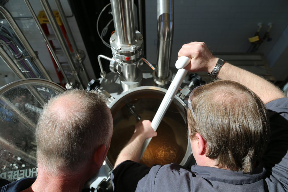 Mike Miziorko (R) stirs the mash during Rahr Malting's new pilot brewery // Photo courtesy of Rahr Malting Company