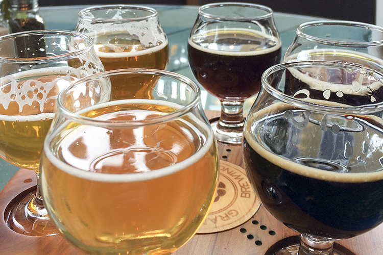 Flight of beers at Grand Rounds Brewpub // Photo by Brian Kaufenberg