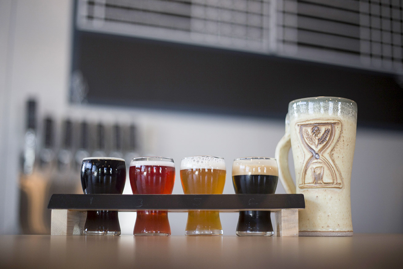 Flight of Imminent Brewings beer and stoneware mug // Photo by Louis Garcia