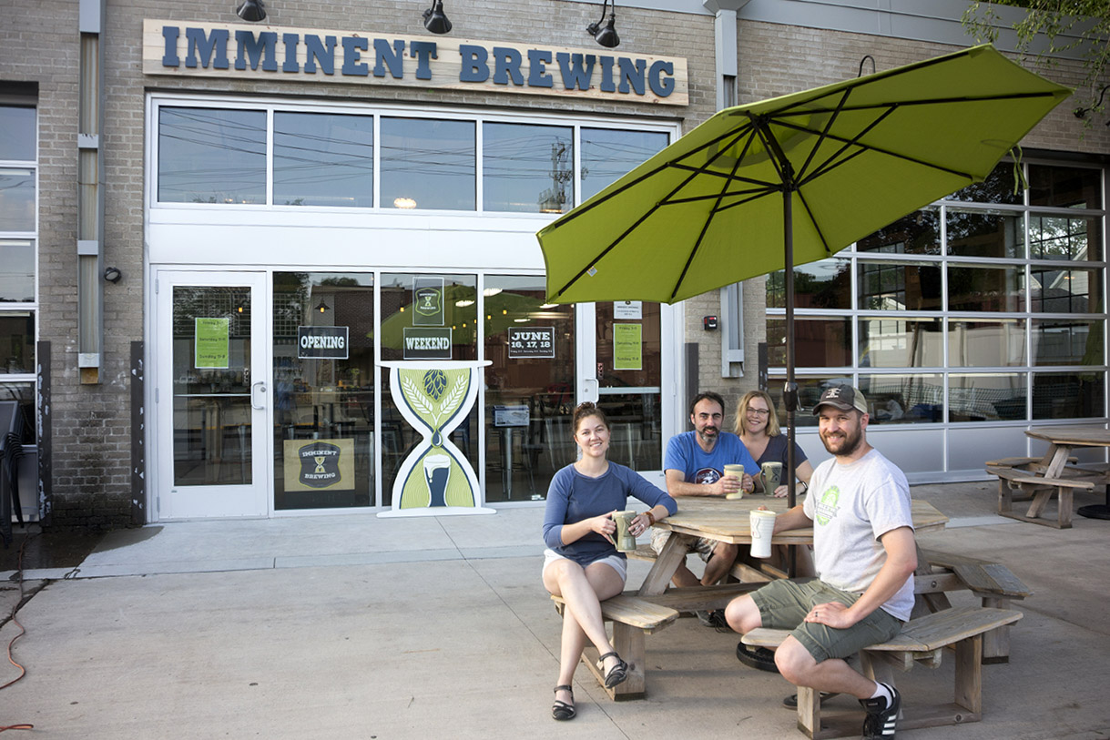 Imminent Brewing's cofounders (L to R) Laura Meyers, Randy Clay, Tonja Clay, and Derek Meyers // Photo by Louis Garcia