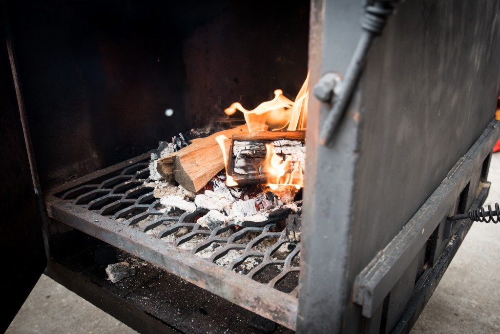 The firebox with a few maple logs, Photo by Kevin Kramer // Growler Magazine