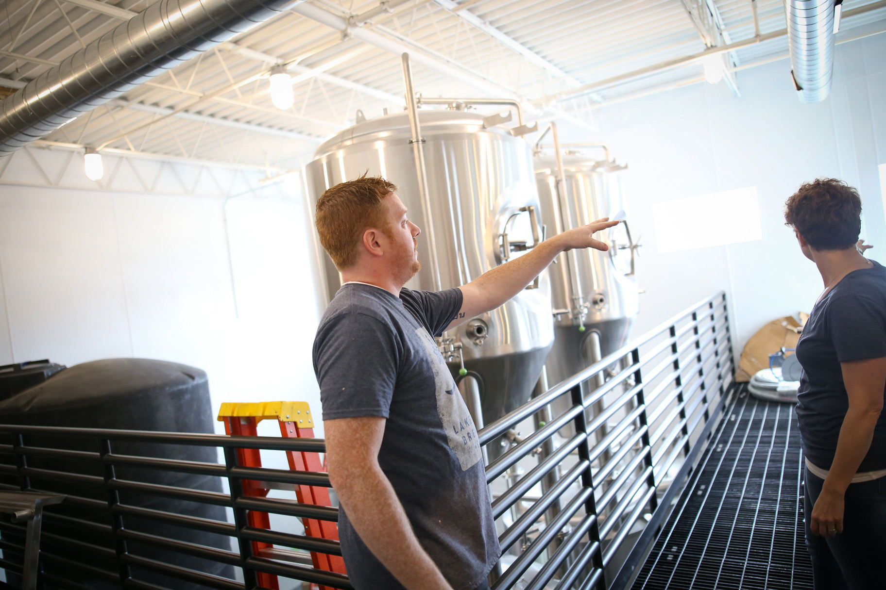 Glen Bruestle, co-owner of Lakeville Brewing, giving a tour of the brewhouse // Photo by Aaron Davidson