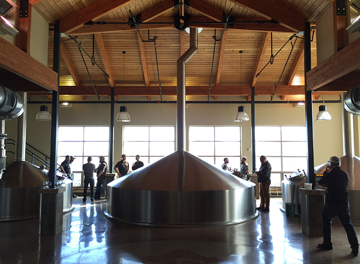 Brewers and memebrs of the Odell, Lift Bridge, and Growler teams prepare for their brew day