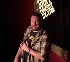 Gus Lynch performing at Joke Joint Comedy Club