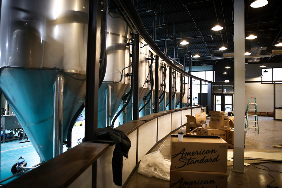 Fermenters border the taproom at Modist // Photo by Aaron Davidson