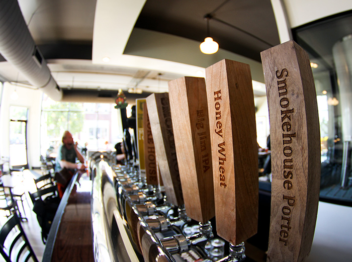 Tap handles at Northbound Smokehouse & Brewpub // Photo by Aaron Davidson