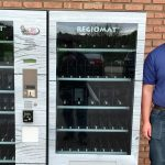 RJ's Meats in Hudson installing a meat vending machine