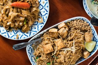 Pad kee mao (left) and tofu pad thai (right) at Supatra's Thai Cuisine // Photo by Kevin Kramer