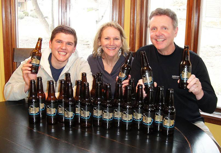 Luke Steadman (left), Barb Anderson (center), and Mark Anderson (right) of Gull Damn Brewing