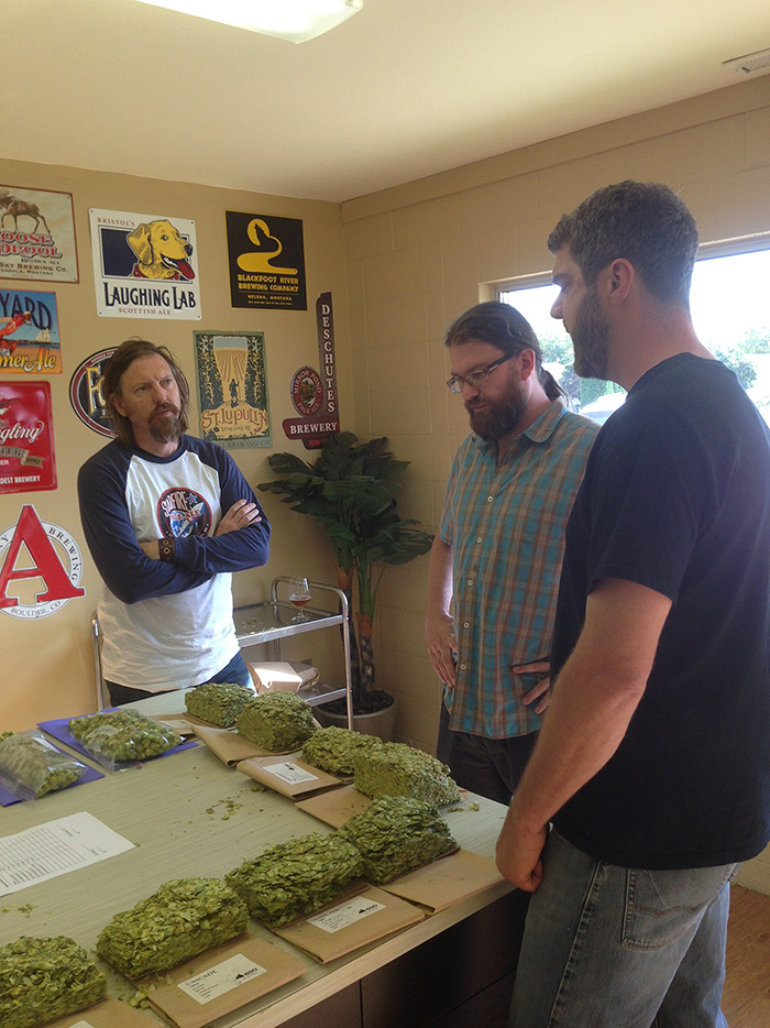 Fitger's Brewhouse owner Tim Nelson, head brewer Frank Kaszuba, and Brewer Supply Group's Chris German prepare to begin hop selection