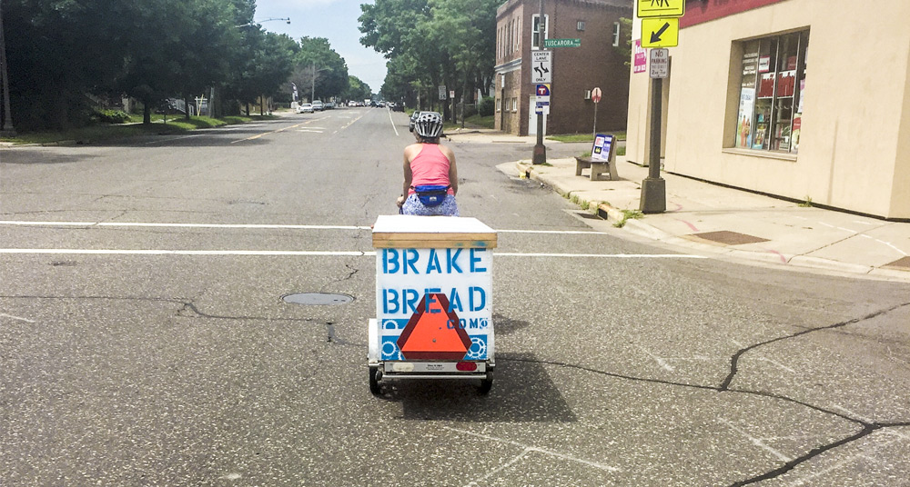 Hannah Field heads out on a bike delivery to Brake Bread's customer // Photo by Sheila Regan