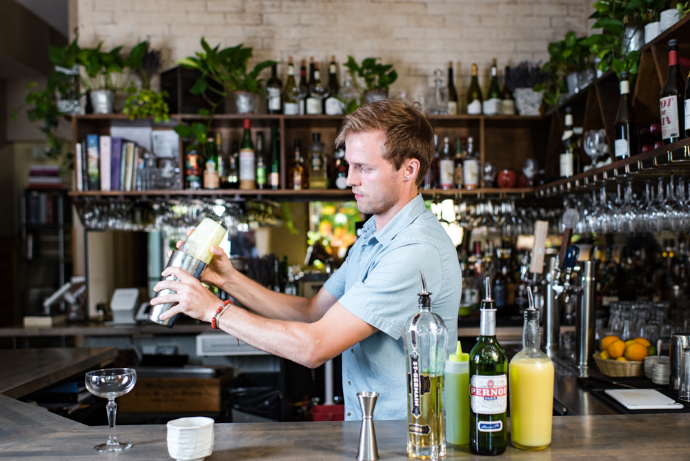 Haden Riles mixes a Wilde at Bar Brigade // Photo by Kevin Kramer, The Growler