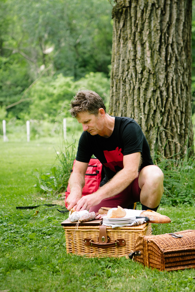 Mike Phillips of Red Table Meat Company slices rounds of salumi for a picnic lunch // Photo by Wing Ta