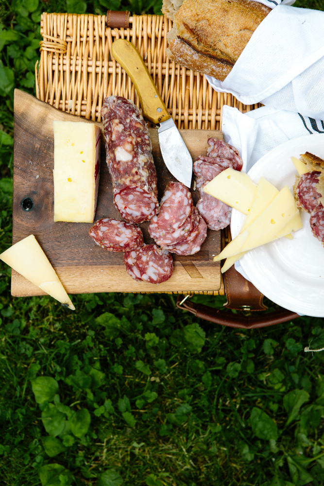 Red Table Meat Company's salumi along with slices of cheese and baguette // Photo by Wing Ta