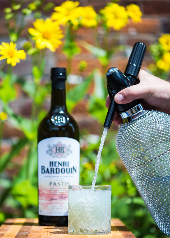 Topping off a dram of Henri Bardouin Pastis with soda water // Photo by Kevin Kramer, The Growler