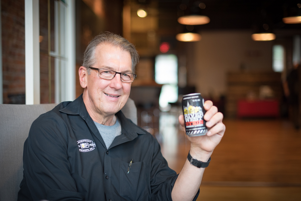 Lakefront Brewery co-founder Jim Klisch hoists a Riverwest Stein Amber Lager, the brewery's flagship beer // Photo by Kevin Kramer