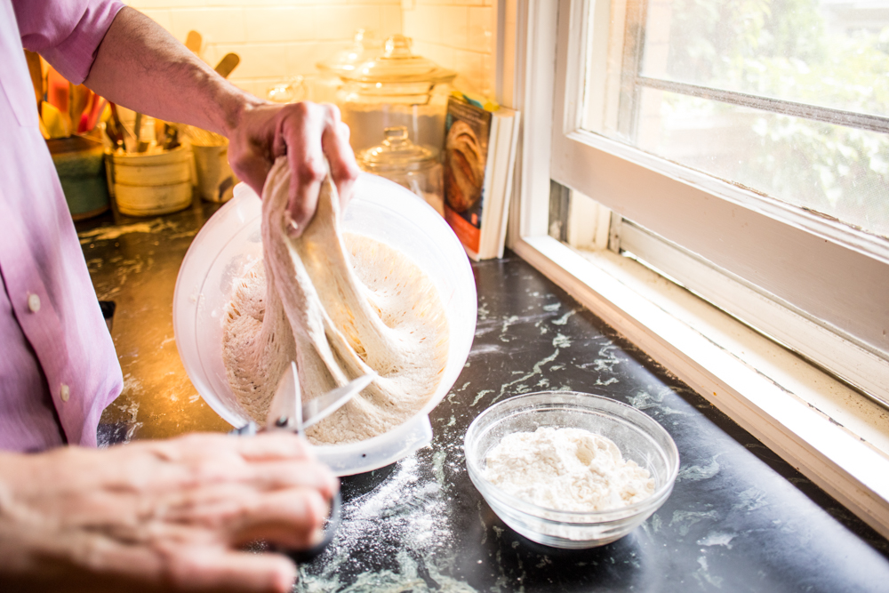 Jeff Hertzberg cuts a hunk of dough off the main batch // Photo by Tj Turner
