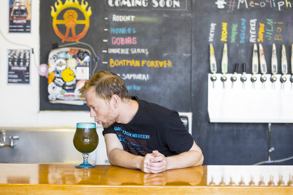 Oliphant brewer Trevor Wirtanen keeps things fun at the brewery // Photo by Tj Turner