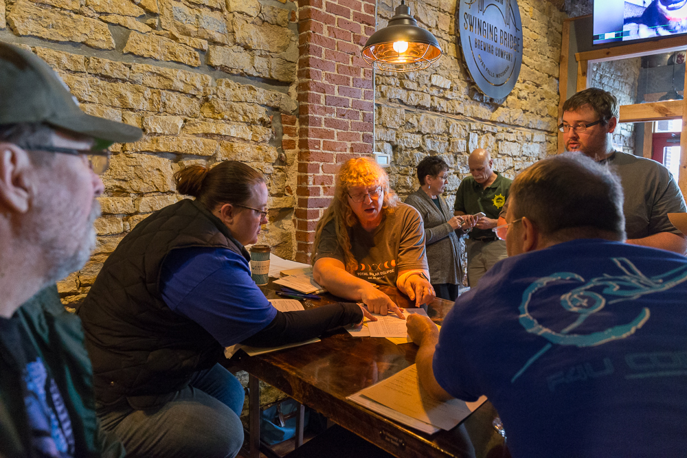 Members of the Twin Cities Rally Club meet at Swinging Bridge Brewing Company to discuss the route for the Falls Colors Rally in October