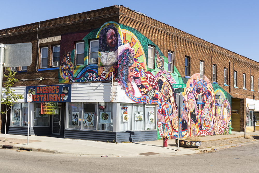 "The full ""BRAIDED"" mural outside of Ghebre's on the corner of Snelling Avenue and Sherburne Avenue // Photo by Tj Turner"