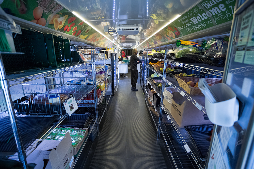 The interior of the Twin Cities Mobile Market buses are lined with shelving, coolers, and produce // Photo by Harrison Barden