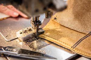 A piece of leather being crafted and sewn into a Red Wing Work Boot // Photo by Barbara O'Brien