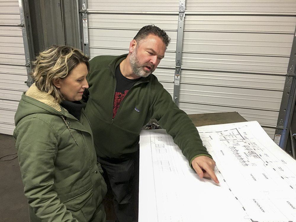 Steve and Dawn Finnie go over plans for Little Thistle Brewery // Photo by Joseph Alton, The Growler