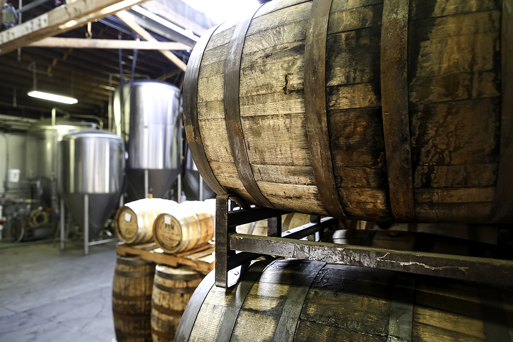 Barrels at Off Color Brewing // Photo by Michael Kiser, Good Beer Hunting