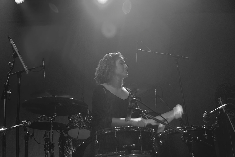 Emma Deaner playing the drums with her band Superior Siren at First Avenue in 2016 // Photo by Thomas Osmonson