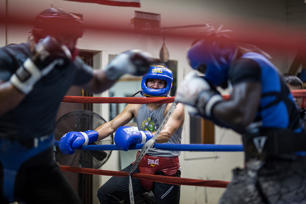 Caleb Truax watches gym-mates and training partners during a sparring match // Photo by Harrison Barden