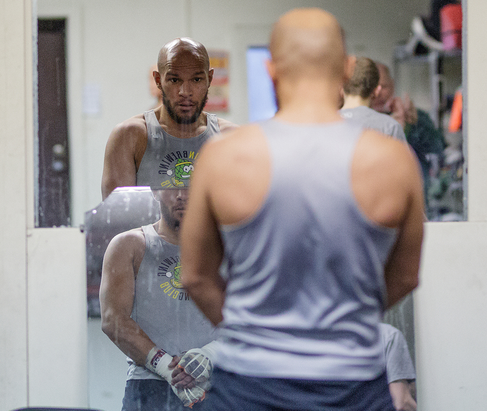 Caleb Truax looks at his reflection during a training session at his gym // Photo by Harrison Barden
