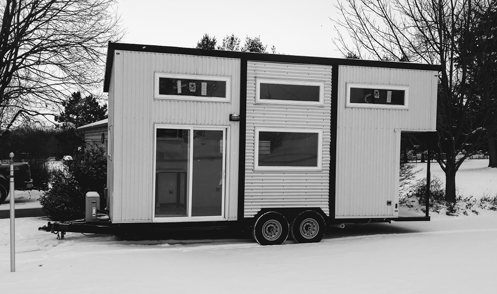 A tiny home built on a trailer, making it mobile // Photo courtesy Jim Wilkins, Tiny Green Cabins