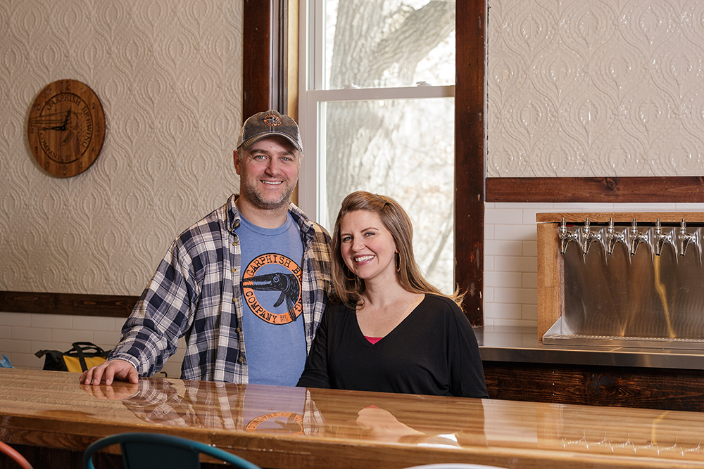 Brandon Lamson and his wife Amanda stand behind the bar of the soon to open Garphish Brewing Company in Bethel // Photo by Harrison Barden