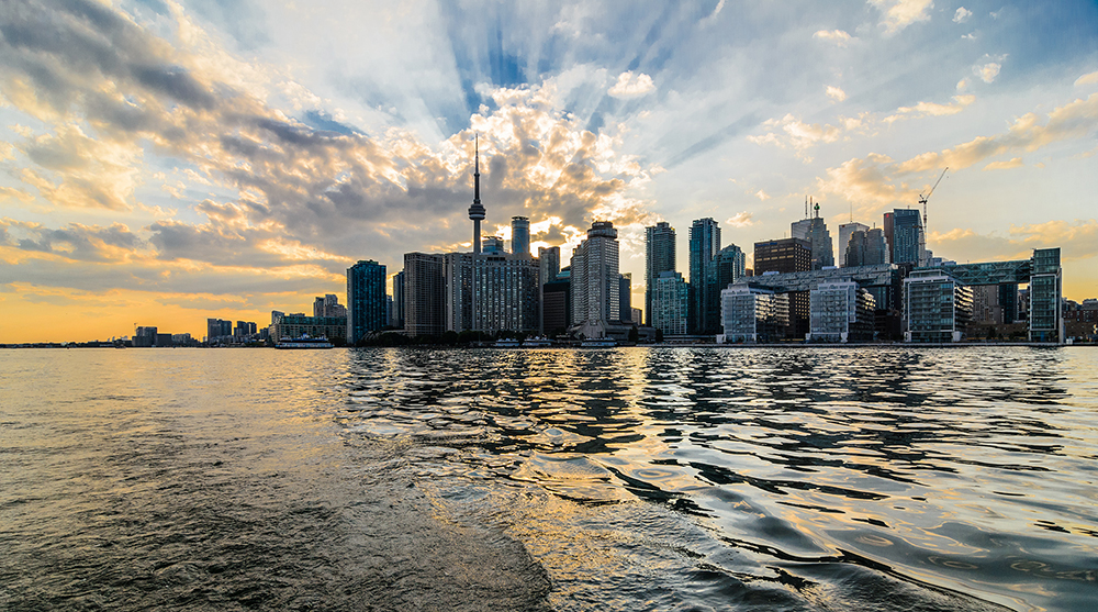 "Toronto's skyline // Photo by Chris Lyn, <a href=""https://www.flickr.com/photos/therealchrislyn/19108076643/"" target=""_blank"" rel=""noopener"">Flickr</a>"