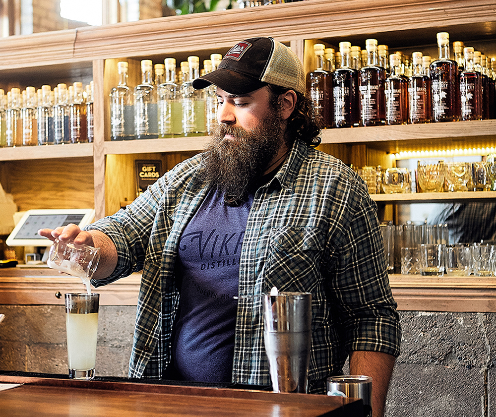 Bertender Pascuzzi prepares a cocktail at Vikre Distillery // Photo by Wing Ta